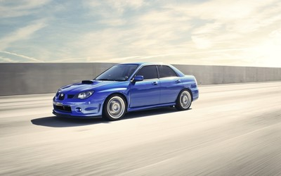 Blue Subaru Impreza WRX STI on the road wallpaper