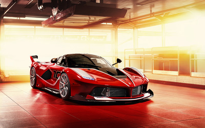 Red Ferrari FXX-K under spotlight wallpaper