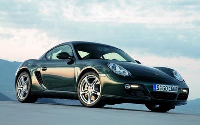 Front side view of a 2009 Porsche Cayman wallpaper