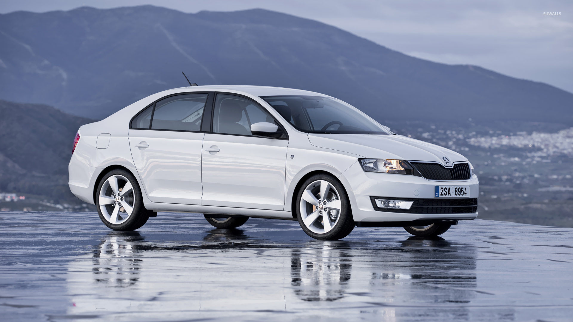 Front Side View Of A 2013 Skoda Rapid Wallpaper Car