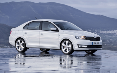 Front side view of a 2013 Skoda Rapid wallpaper