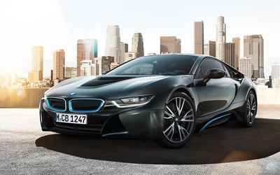 Front side view of a BMW i8 in the city wallpaper