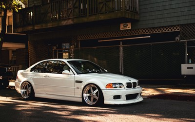Front side view of a white BMW M3 wallpaper