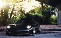 Front view of a black Chevrolet Corvette with headlights on wallpaper 2560x1600 jpg