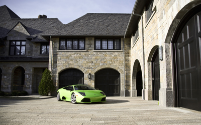 Green Lamborghini Murcielago parked in front of a mansion wallpaper