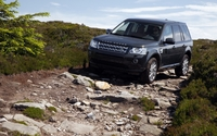 Land Rover Freelander in rocky mountains wallpaper 1920x1200 jpg