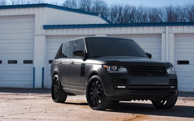 Land Rover Range Rover in front of garages wallpaper