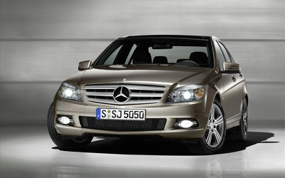 Mercedes-Benz C-Class front view with headlights on wallpaper