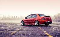 Mitsubishi Lancer Evolution on a rainy day wallpaper 1920x1200 jpg