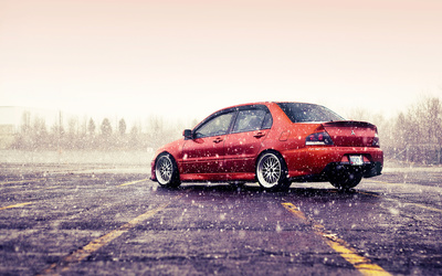 Mitsubishi Lancer Evolution on a rainy day wallpaper