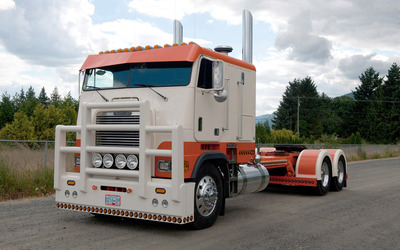 Orange and white Freightliner truck wallpaper