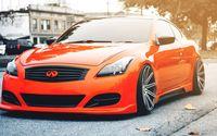 Orange Infiniti G37 coupe on the road wallpaper 2560x1440 jpg