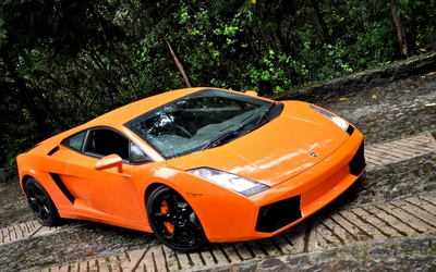 Orange Lamborghini Aventador on a country road wallpaper