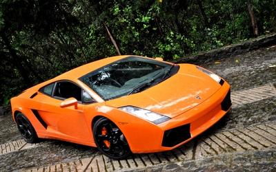 Orange Lamborghini Aventador on a country road Wallpaper