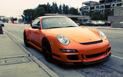 Parked orange Porsche 997 GT3 RS wallpaper