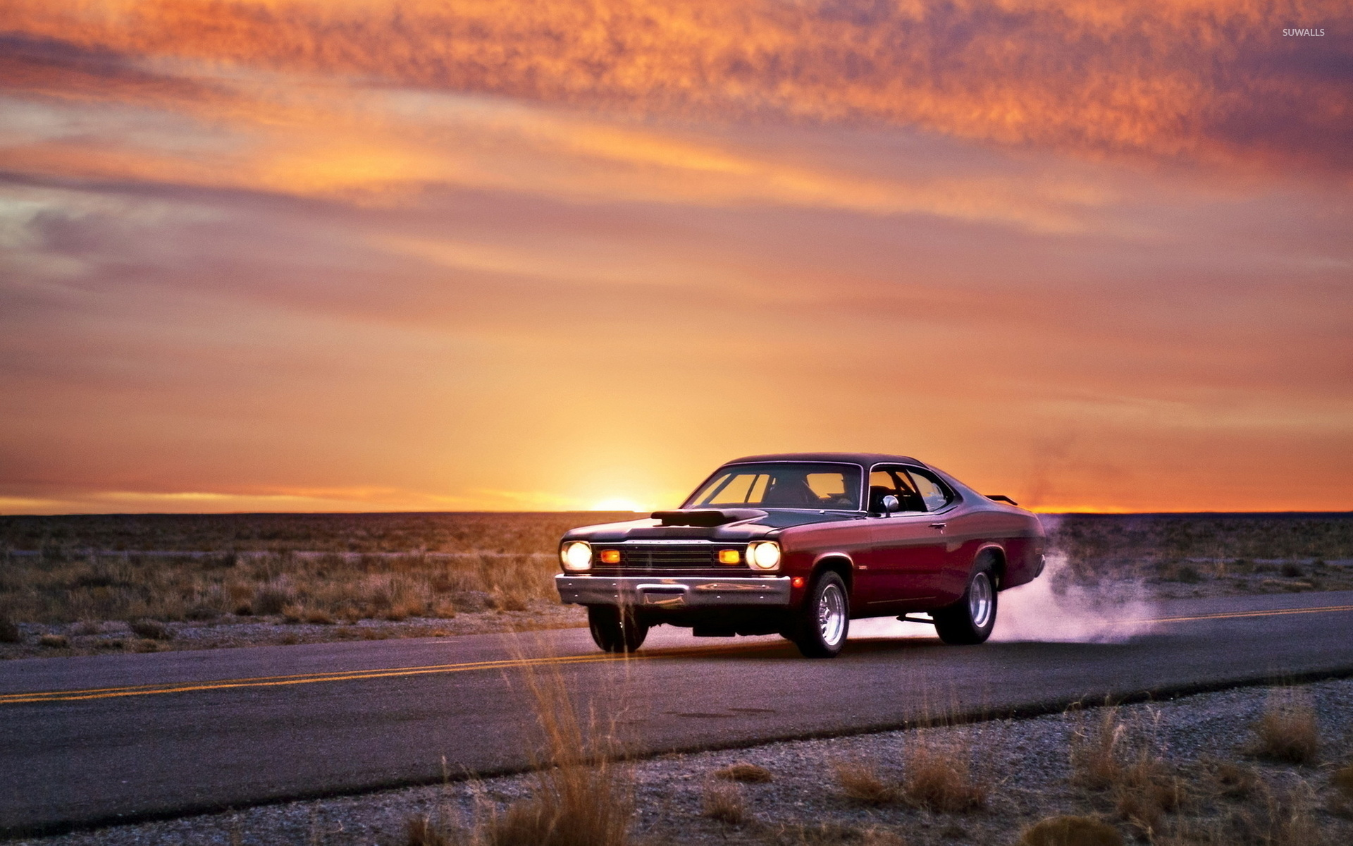 Plymouth Duster On The Road At Sunset Wallpaper