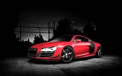 Red Audi R8 by a fence wallpaper