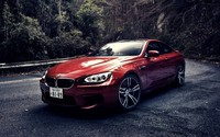 Red BMW M6 on a mountain road wallpaper 1920x1080 jpg