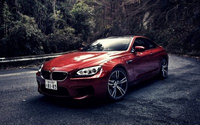 Red BMW M6 on a mountain road wallpaper