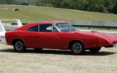 Red Dodge Charger Daytona on a country road wallpaper