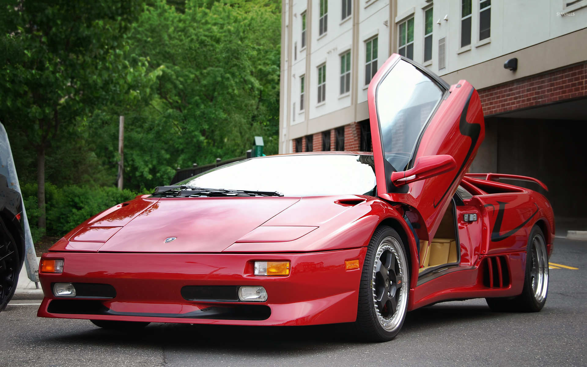 Red Lamborghini Diablo With An Open Door Front Side View Wallpaper