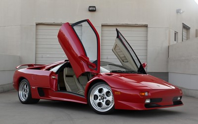 Red Lamborghini Diablo with doors opened wallpaper