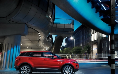 Red Land Rover Range Rover Evoque under a bridge wallpaper