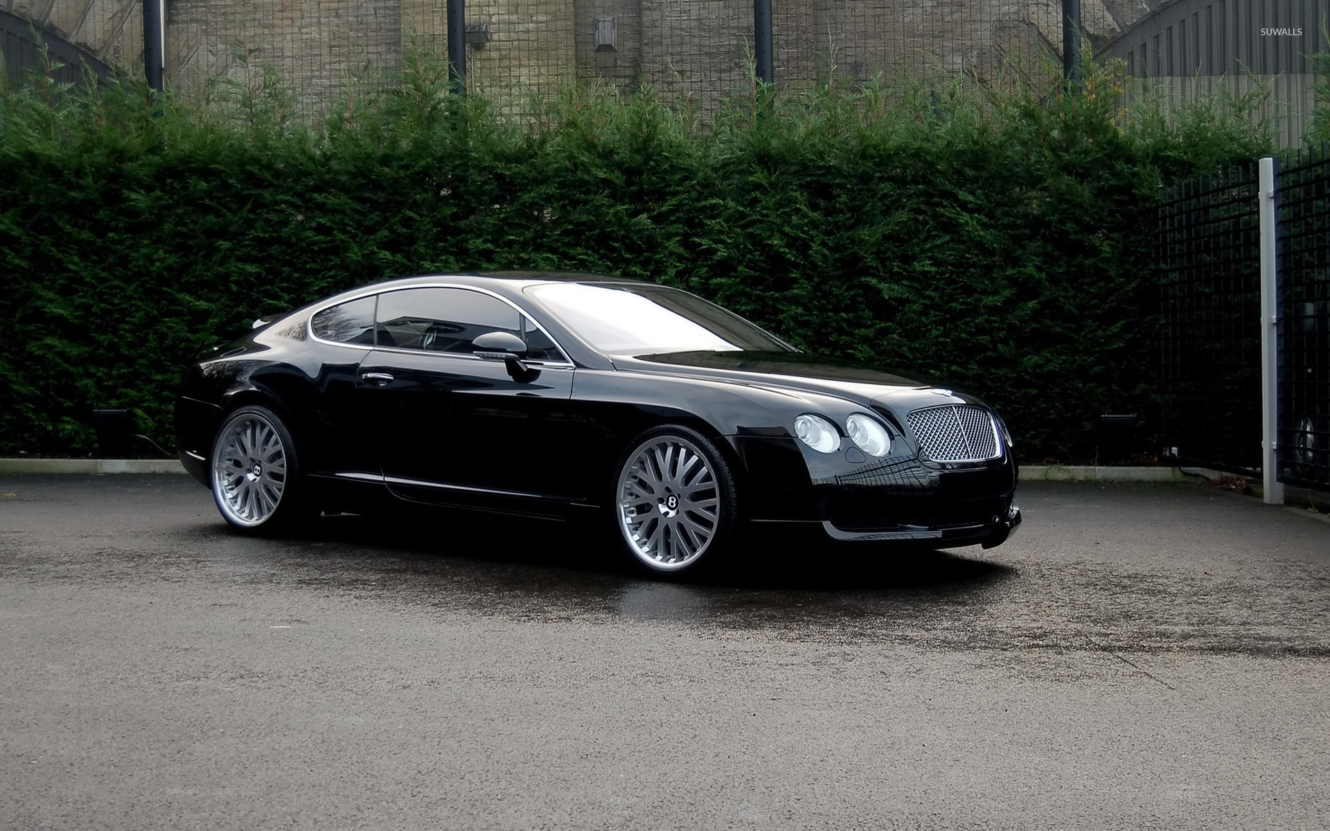 Side View Of A Black Bentley Continental Gt Wallpaper