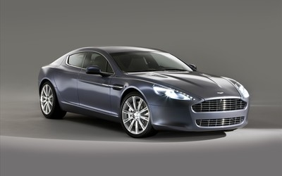 Silver Aston Martin Rapide with headlights on wallpaper