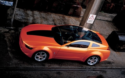 Top view of an orange Ford Mustang wallpaper