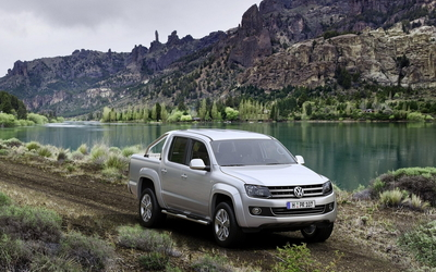 Volkswagen Amarok on a country road by the lake wallpaper
