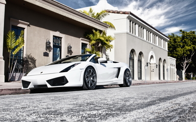 White 2015 Lamborghini Huracan in front of a mansion wallpaper