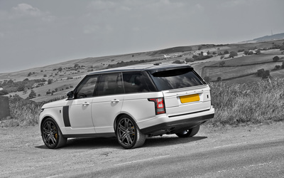 White A Kahn Design Land Rover Range Rover by the road side wallpaper
