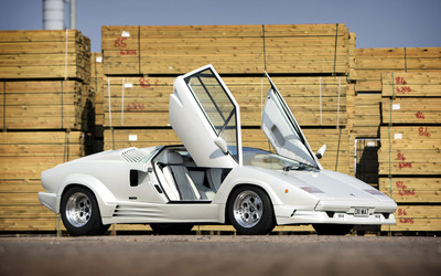 White Lamborghini Countach with opened doors wallpaper