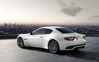 White Maserati GranTurismo in a parking lot above the city wallpaper 1920x1200 jpg