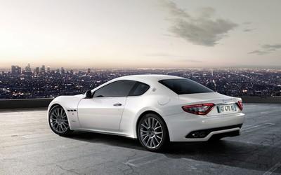 White Maserati GranTurismo in a parking lot above the city wallpaper