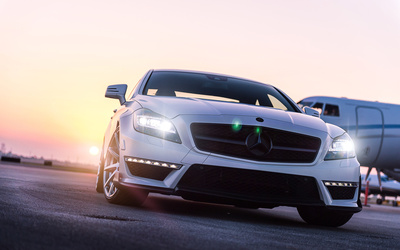 White Mercedes-Benz CLS-Class at sunset wallpaper
