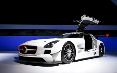 White Mercedes-Benz SLS AMG in a show room wallpaper