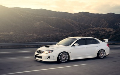 White Subaru Impreza WRX STI on the road wallpaper