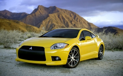 Yellow 2010 Mitsubishi Eclipse front side view wallpaper