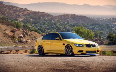 Yellow BMW M3 side view wallpaper