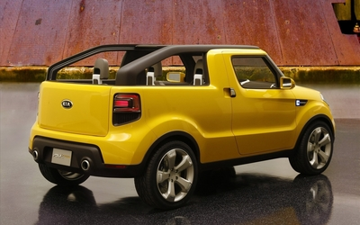 Yellow Kia Soul'ster back side view wallpaper