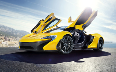 Yellow McLaren P1 with opened doors Wallpaper