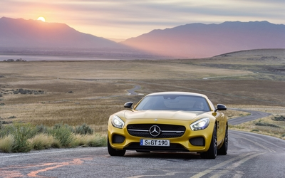 Yellow Mercedes-Benz SLS AMG at sunset wallpaper
