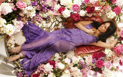 Alicia Keys in a purple dress between flowers wallpaper