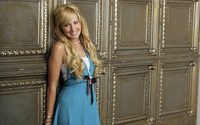 Ashley Tisdale leaning on a wall wallpaper 1920x1200 jpg
