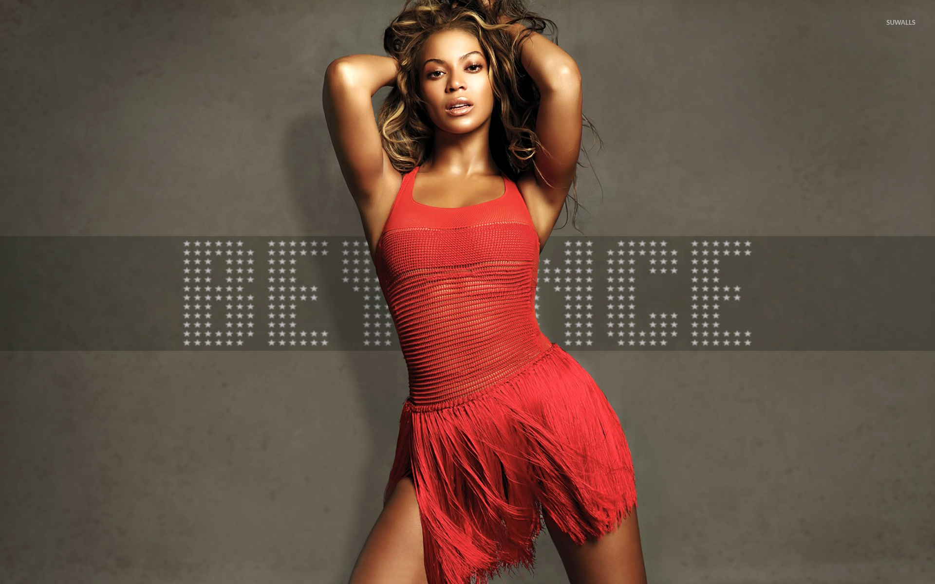 Beyonce in a red dress and with both hands in her hair wallpaper ...