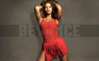 Beyonce in a red dress and with both hands in her hair wallpaper 1920x1200 jpg