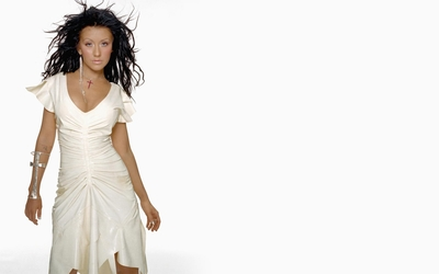 Brunette Christina Aguilera with hair blowing in the wind wallpaper
