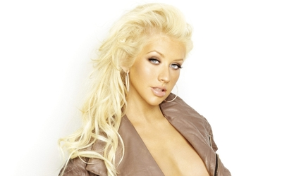 Christina Aguilera in a brown leather jacket wallpaper